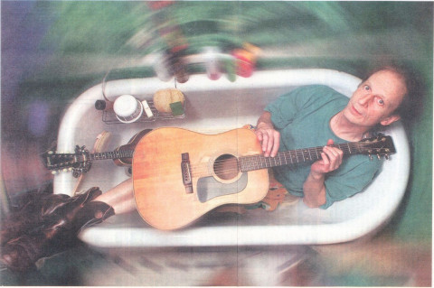 Joe Hall in bathtub - Cordova Bay Archives